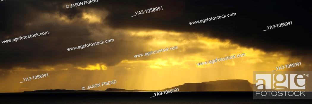Stock Photo: Scotland, Western Isles, Isle of Soay  Dramatic shafts of light from the settin sun above the Isle of Soay, viewed from Elgol on the Isle of Skye.