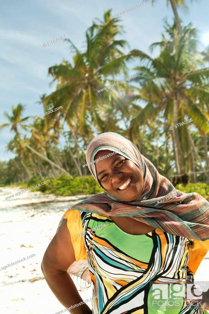 Stock Photo: Local woman on beach on Zanzibar Island.