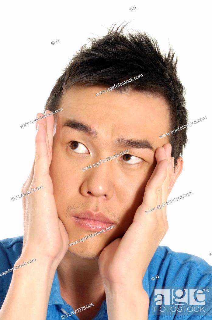 Stock Photo: Male university student suffering from a headache.