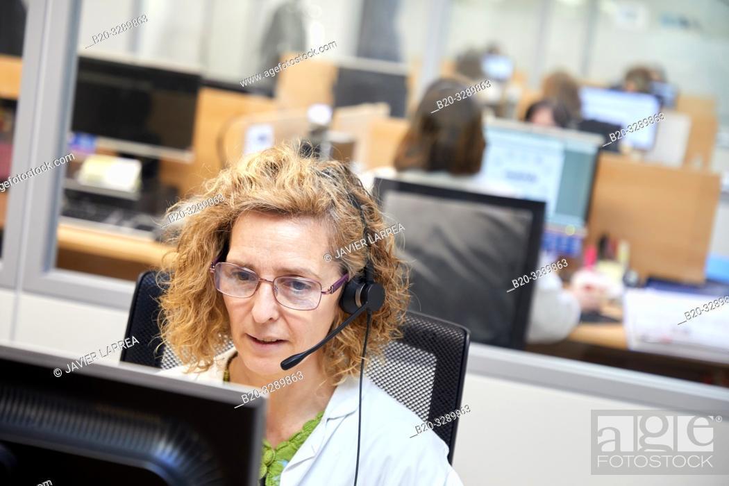 Stock Photo: Telephonist,ICC, Integrated Call Center, CIAT, Centro Integrado de Atención Telefónica, Hospital Donostia, San Sebastian, Gipuzkoa, Basque Country, Spain.
