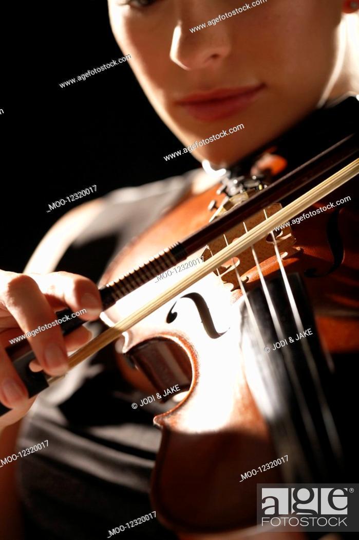 Stock Photo: Woman Playing Violin close-up.