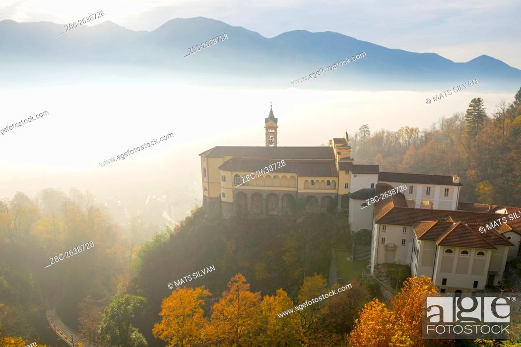 Stock Photo: Monastery Madonna del Sasso with sea of fog and sunlight and swiss alps in Locarno, Switzerland.