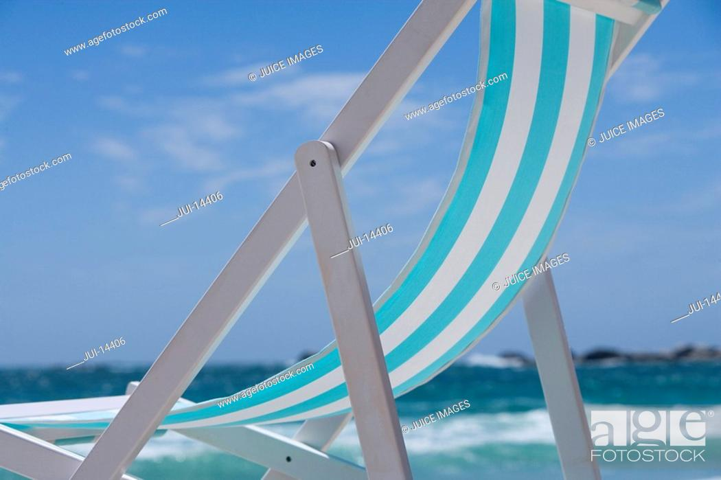 Stock Photo: Deck chair on beach, low angle view.
