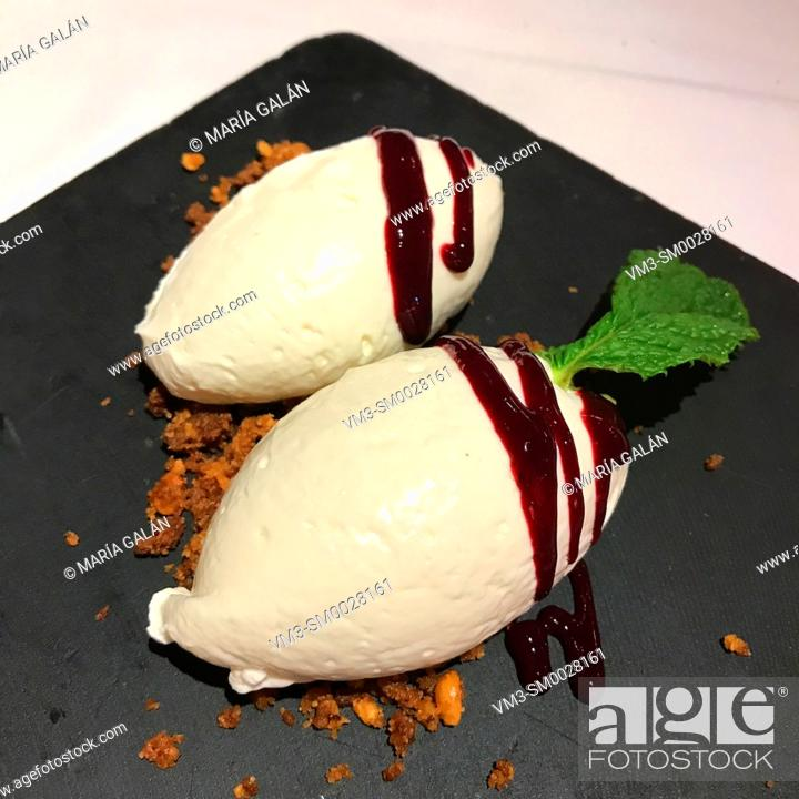 Stock Photo: Cheese cake with raspberry syrup, biscuit powder and mint leaf.