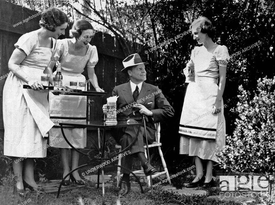 Stock Photo: Washington D.C.: May 4, 1933.Members of Washington's Junior League practice serving foaming steins of beer in their garden at home before serving it in the Beer.