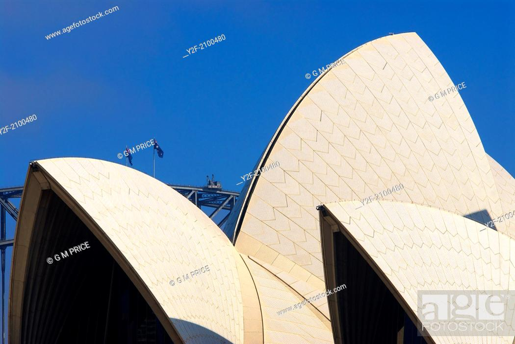 Stock Photo: roof of Sydney Opera House framed against the peak of the Sydney Harbour Bridge.