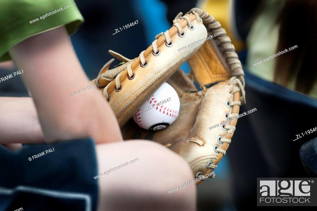 Stock Photo: Young boy holding baseball glove with ball in the mitt.