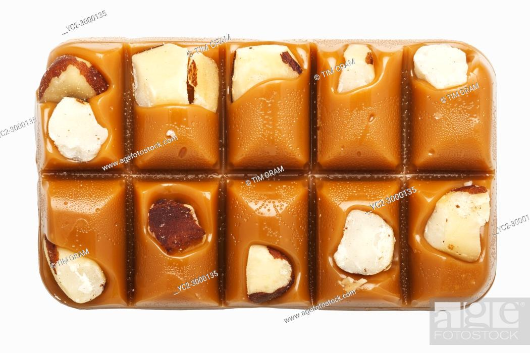 Stock Photo: A slab of Walker's Brazil Nut Toffee on a white background.