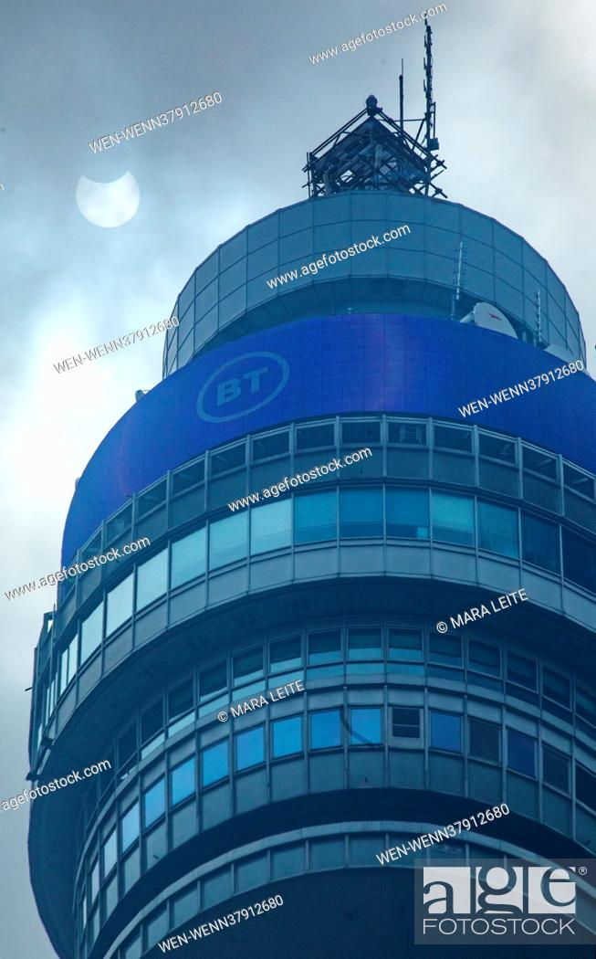 Stock Photo: The 2021 solar eclipse can be seen over the BT Tower in Fitzrovia, London, United Kingdom. Photographer Mara Leite snapped these images at exactly 11.