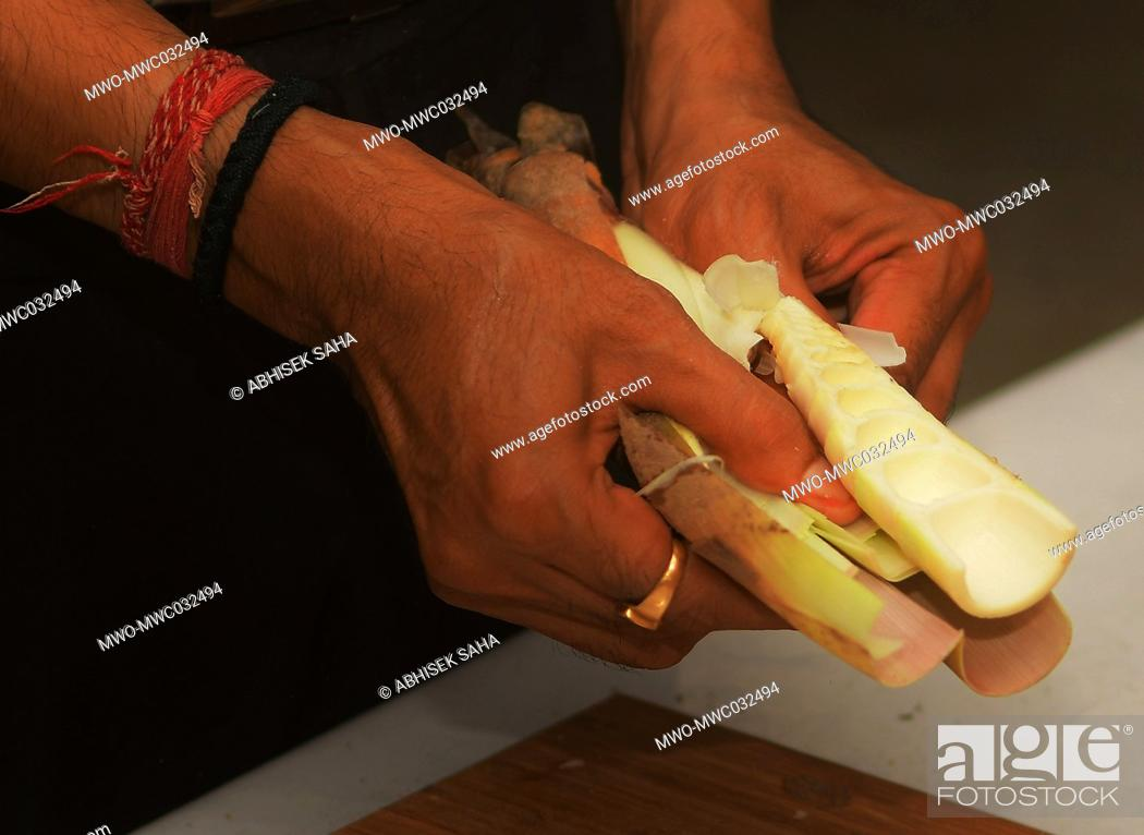 Stock Photo: The head of BCDI (Bamboo and Cane Development Institute) Dr. Abhinav Kant, is making cookies out of Bamboo Shoot. The cookies have been made of muli bamboo.