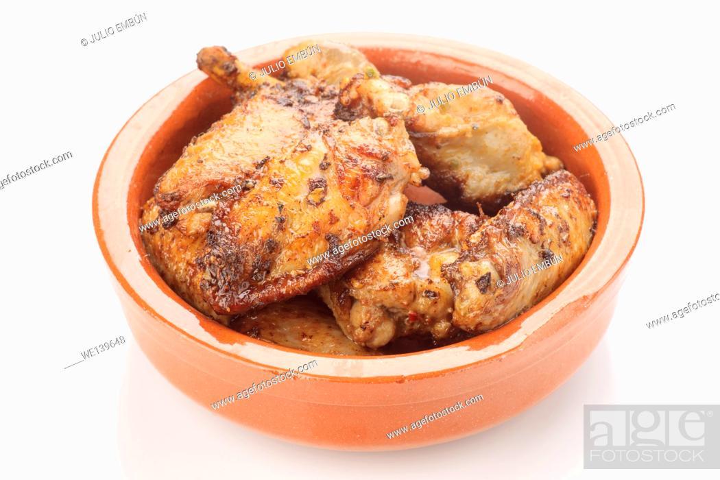 Photo de stock: fried chicken wings in mud pie.