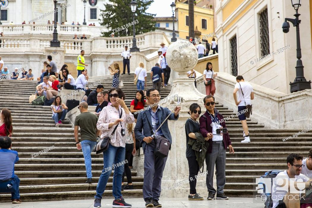 Stock Photo: Asian tourists taking a selfie at the Spanish Steps in Rome, Italy.