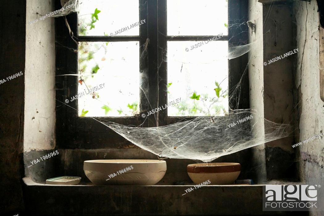 Stock Photo: Cobwebs in a window of an old farmhouse, La Creuse, Limousin, France.