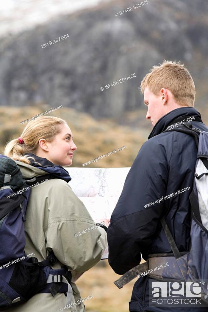 Stock Photo: A couple orienteering.