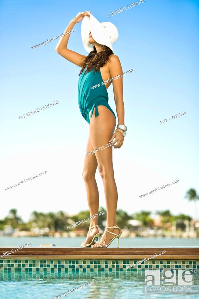 Stock Photo: Woman standing at the poolside.