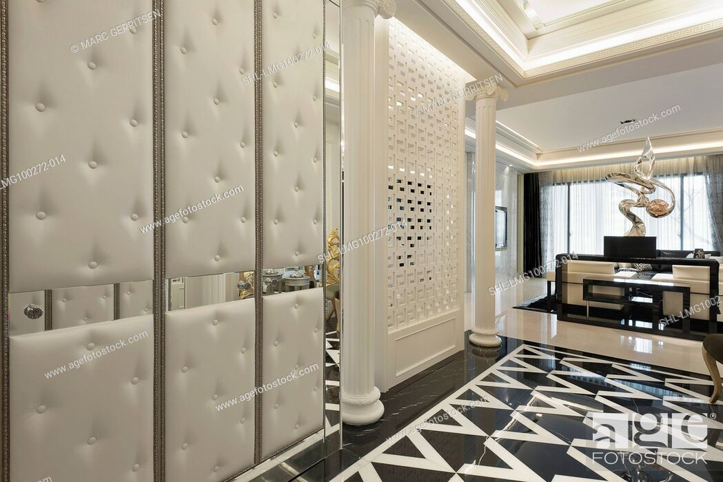 Imagen: Hallway of elegant home with black and white marble flooring.