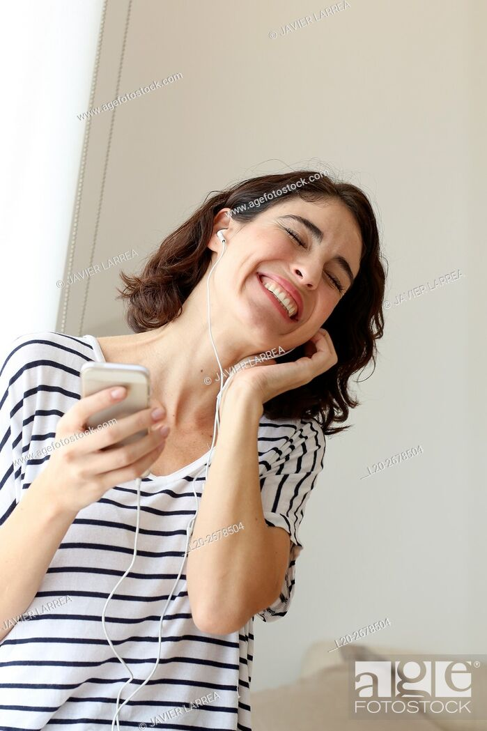 Stock Photo: Woman listening music with Smartphone.