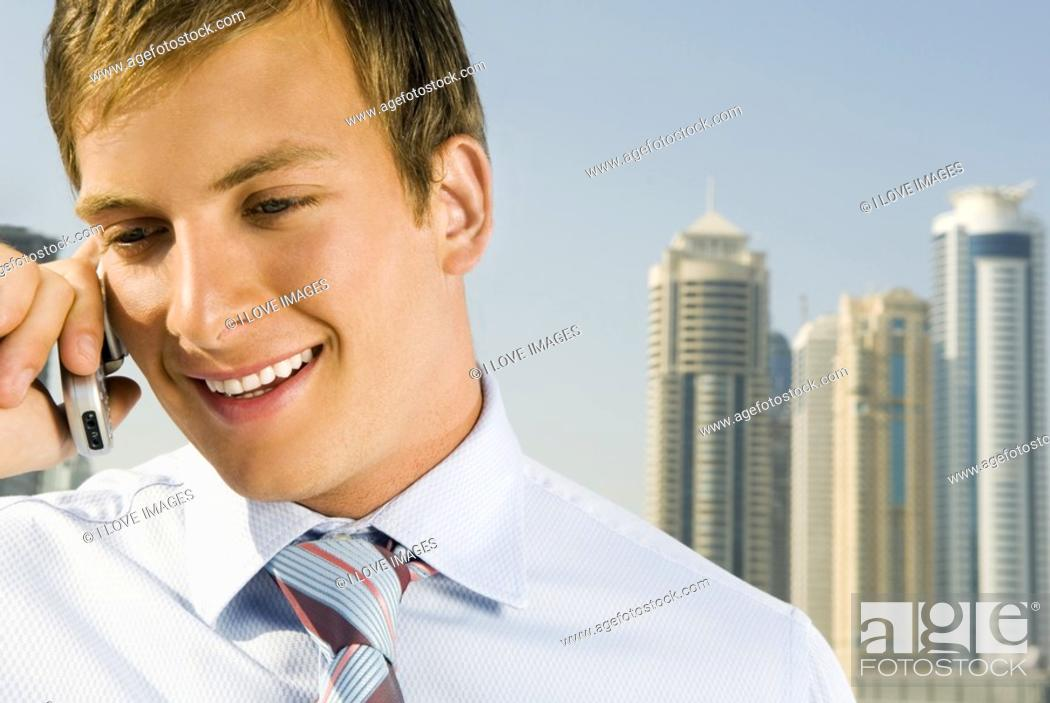 Stock Photo: A businessman talking on a mobile phone.