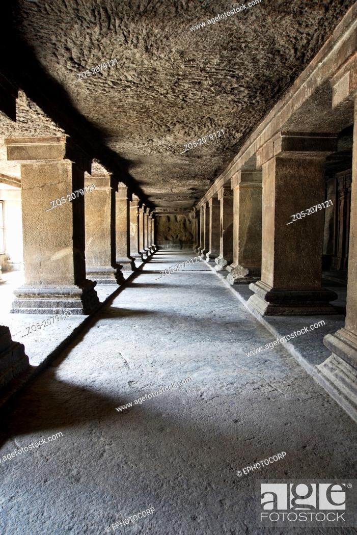 Stock Photo: View of row of pillars in verandah and an unfinished panel on the south. Pataleshwar rock-cut temple, Jangli Maharaj road Pune.