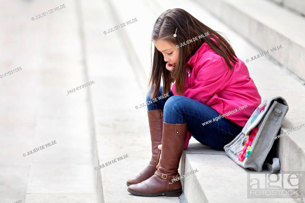 Stock Photo: Girl sitting on the steps.