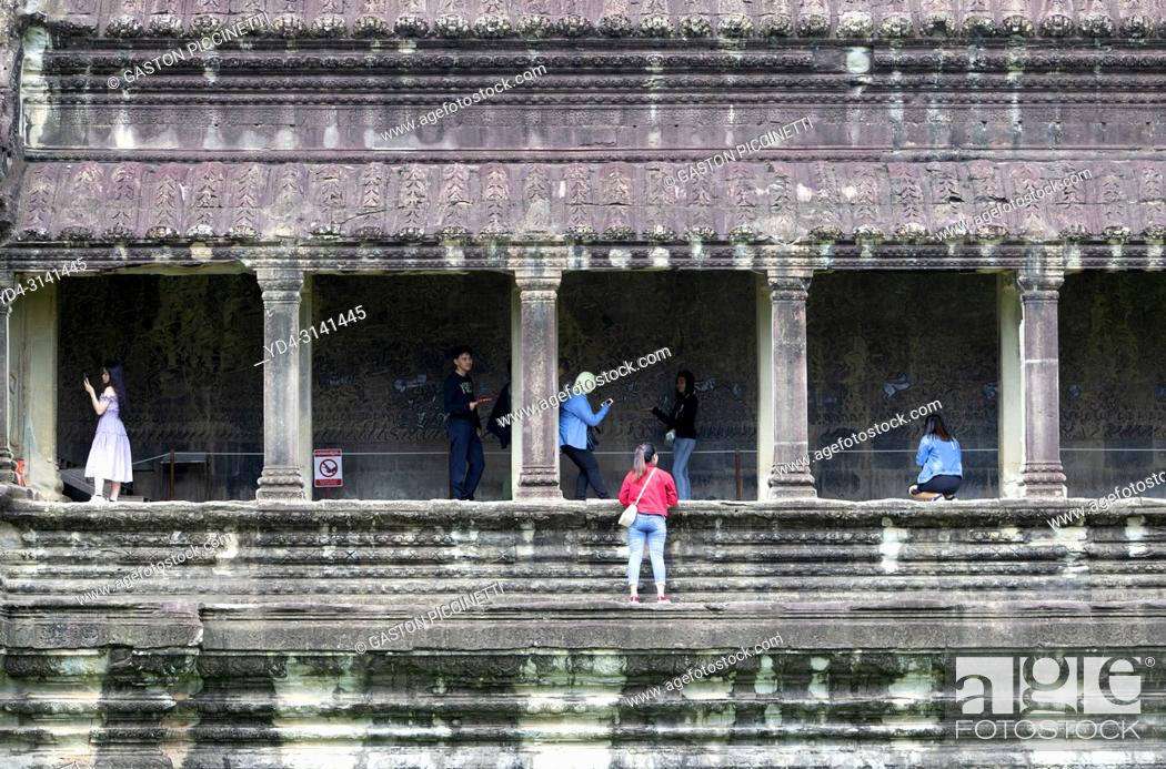 Stock Photo: Tourists exploring the Angkor Wat Temple, Angkor Temple Complex, Siem Reap Province, Cambodia, Asia, UNESCO. It was originally constructed as a Hindu temple.
