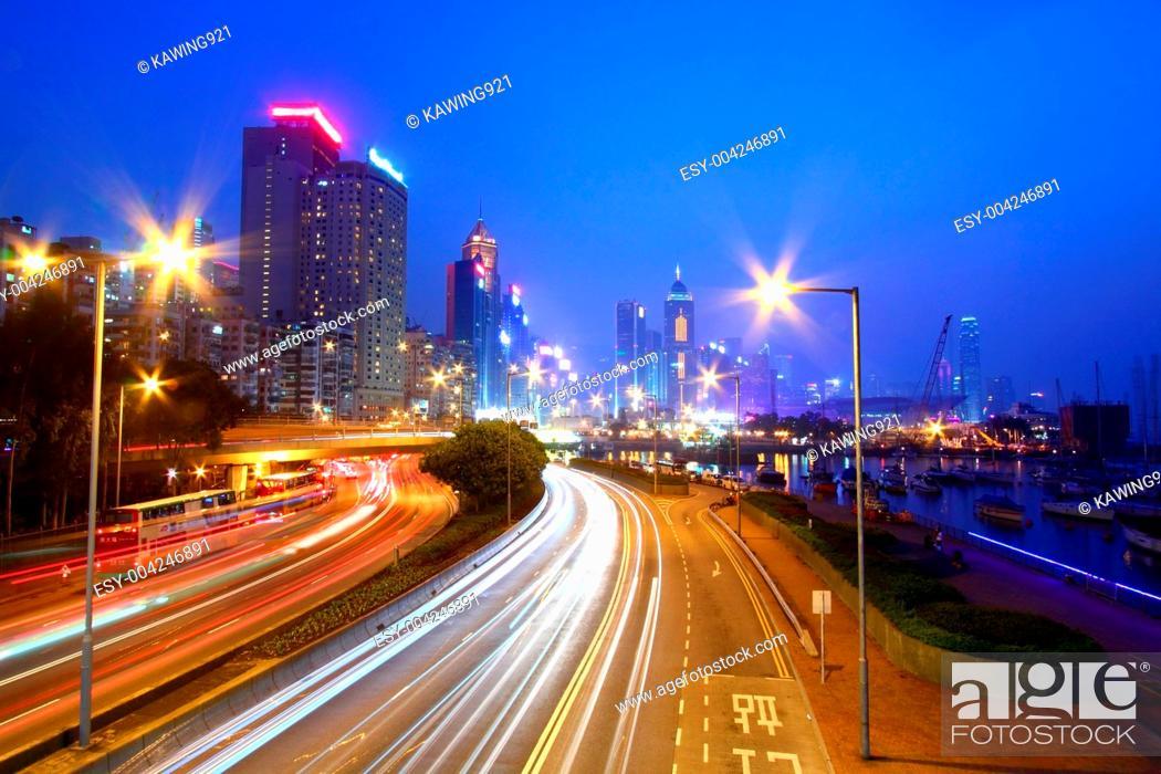 Stock Photo: Traffic through downtown of Hong Kong at night.