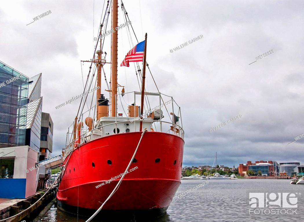 Stock Photo: This huge red American ship is docked in a seaport of Balitmore Bay, Maryland while tied to a dock.