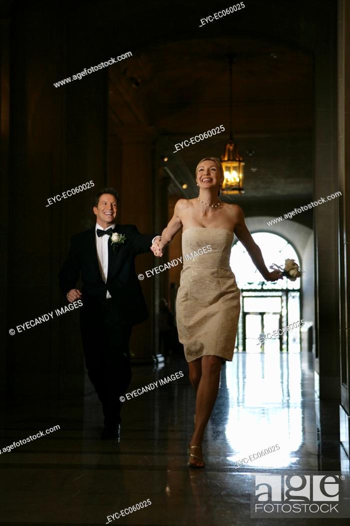 Stock Photo: Couple running down a corridor.