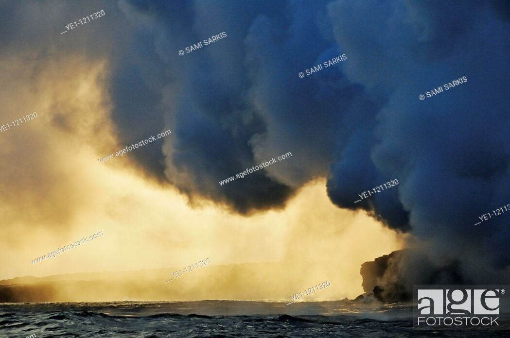 Stock Photo: Steam rising off lava flowing into ocean at sunset, Kilauea Volcano, Hawaii Islands, United States.