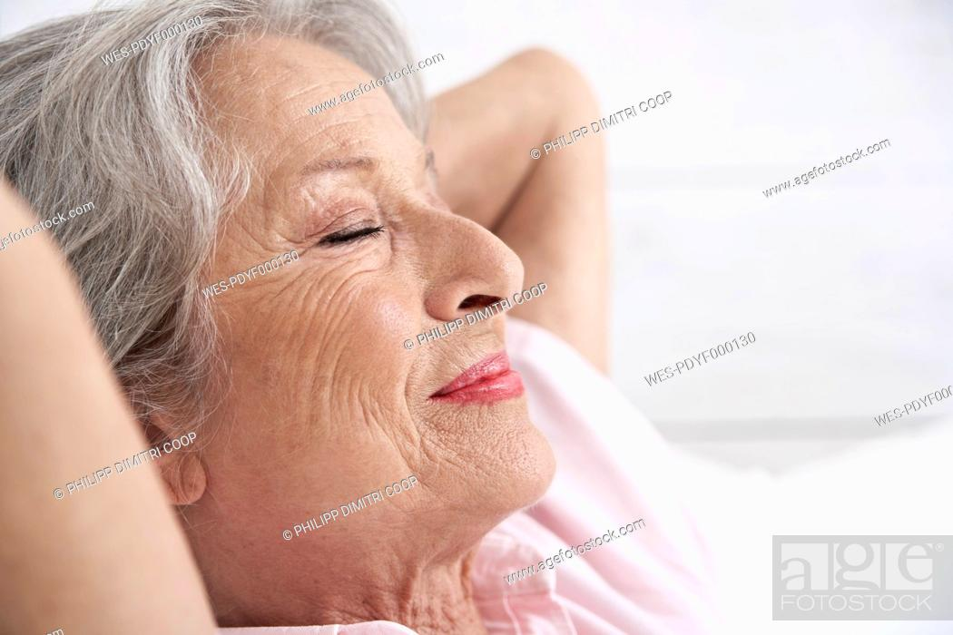 Stock Photo: Spain, Senior woman relaxing, smiling.