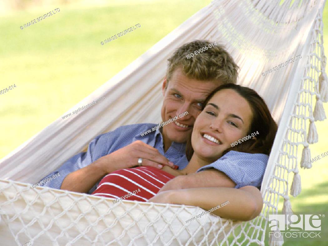 Stock Photo: Couple in hammock.