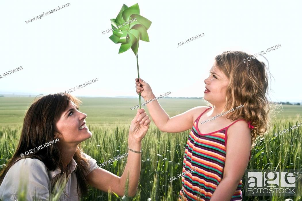Stock Photo: Woman and child holding toy windmill.