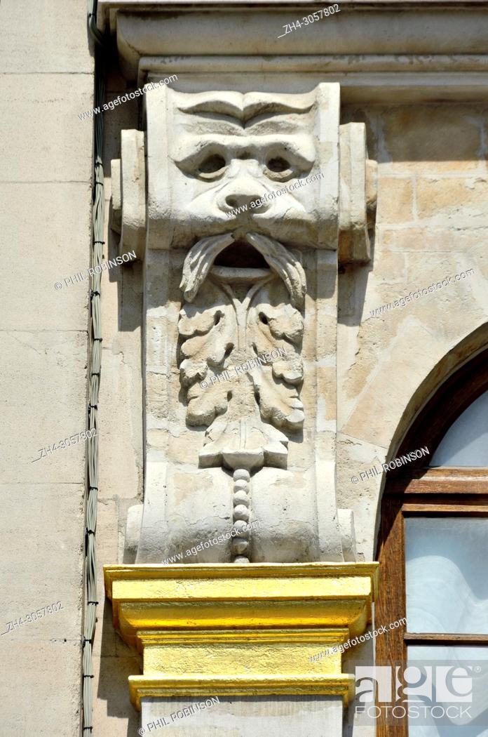 Stock Photo: Brussels, Belgium. Grand Place: Mascaron on facade of no. 26 - 'Maison du Pigeon'.