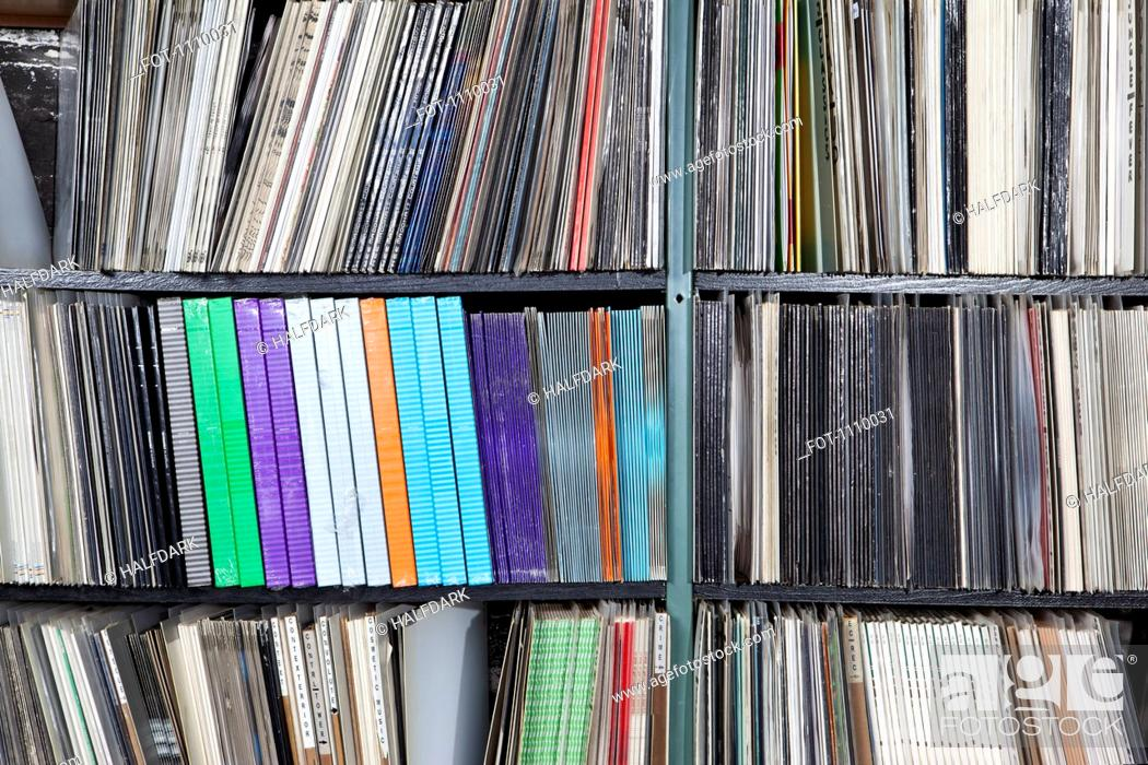 Stock Photo: Rows of records on shelves.