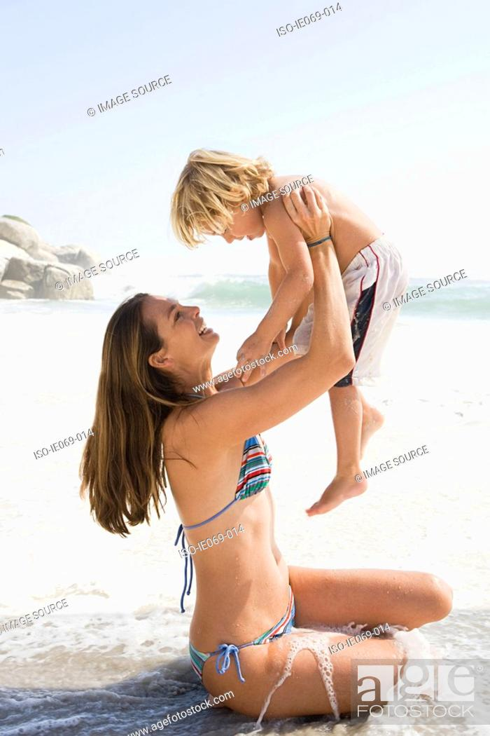 Stock Photo: Mother and son in the sea.