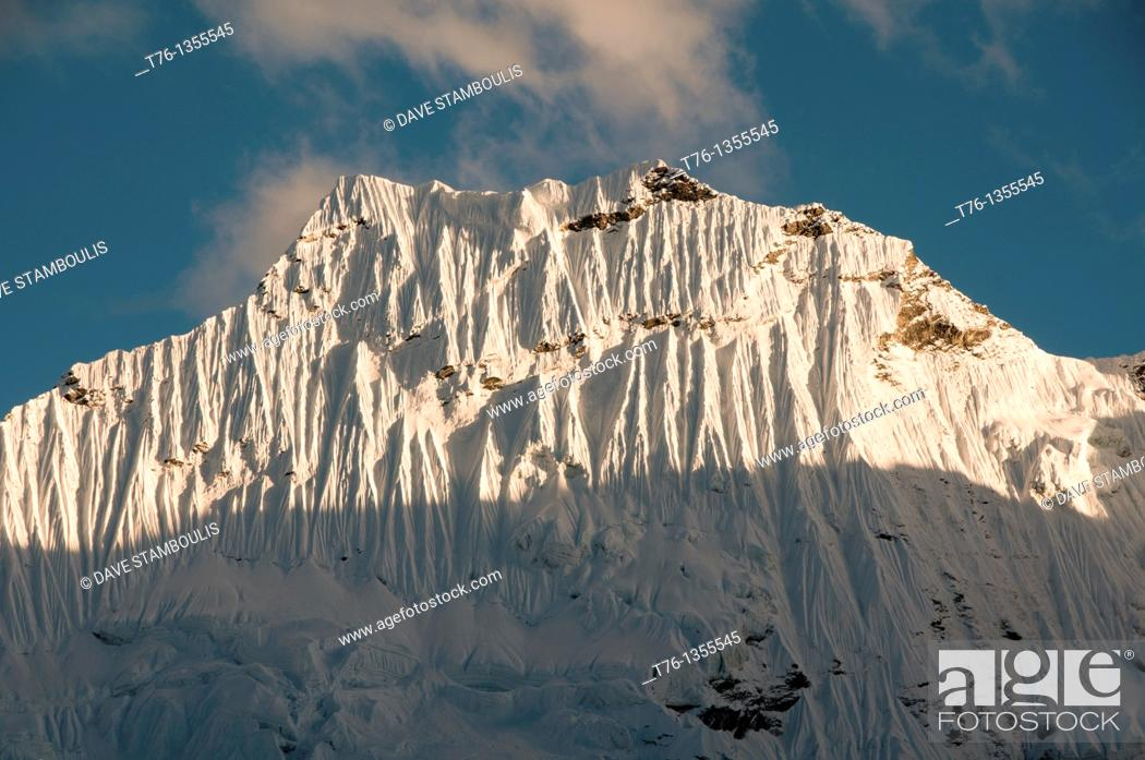 Stock Photo: serrated ice walls of Amphu Lapcha peak in the Everest Region of Nepal.
