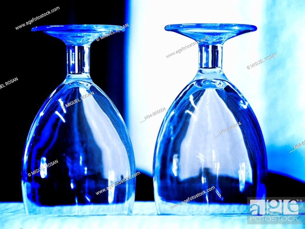 Stock Photo: Tack blue image of two glasses on the table upside down Restaurant Don Baco La Cañada. Valencia. Spain. Europe.