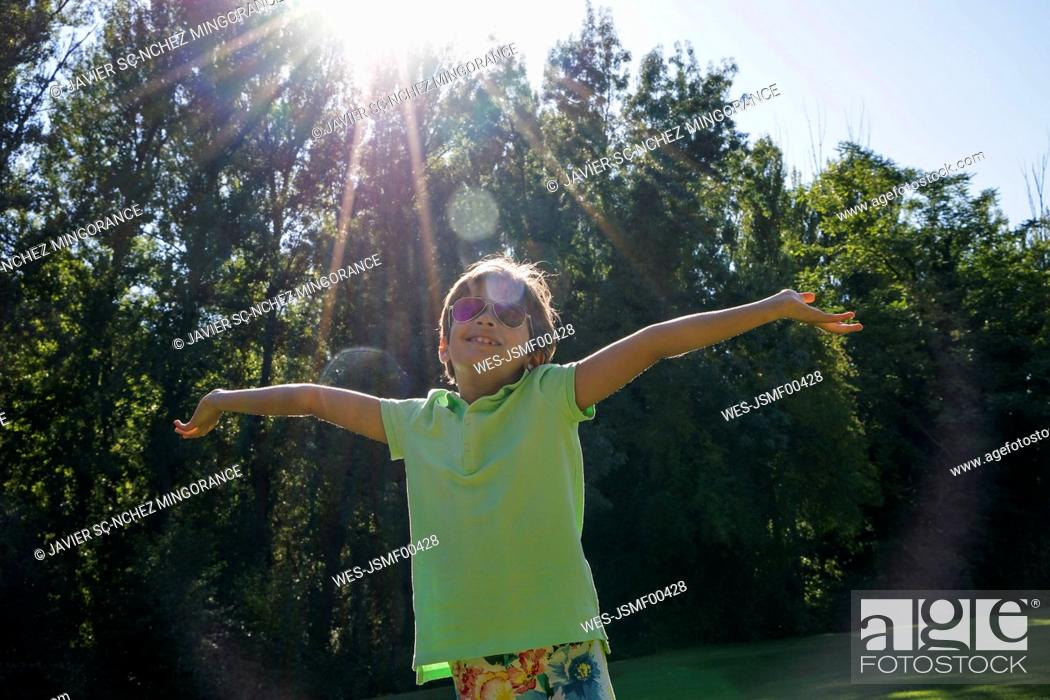 Stock Photo: Young girl under the rays of the sun.