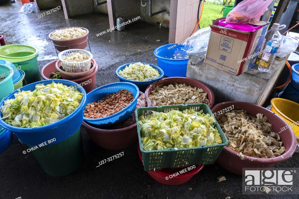 Stock Photo: Volunteers preparing vegetarian foods for the Chinese New Year Festival Capgomeh year 2019 15th day of the 1st month at Siniawan, Sarawak, Malaysia.