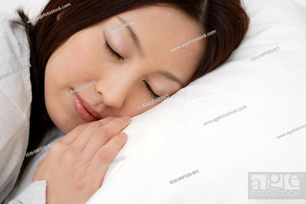 Stock Photo: A young woman sleeping peacefully.
