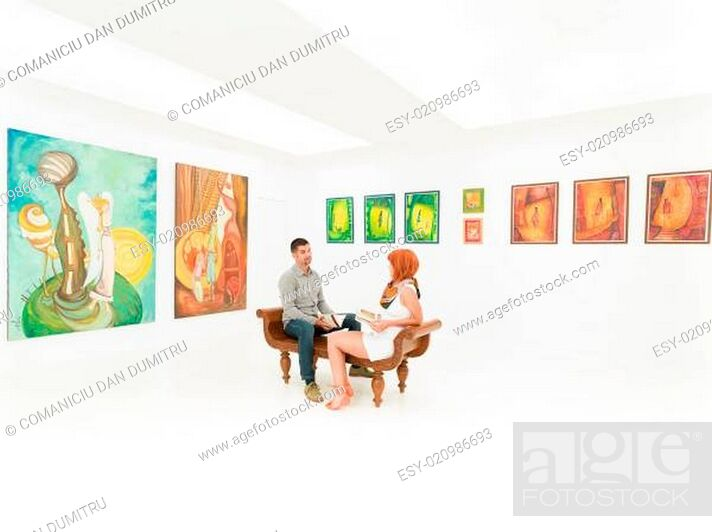 Stock Photo: young couple talking about artworks.