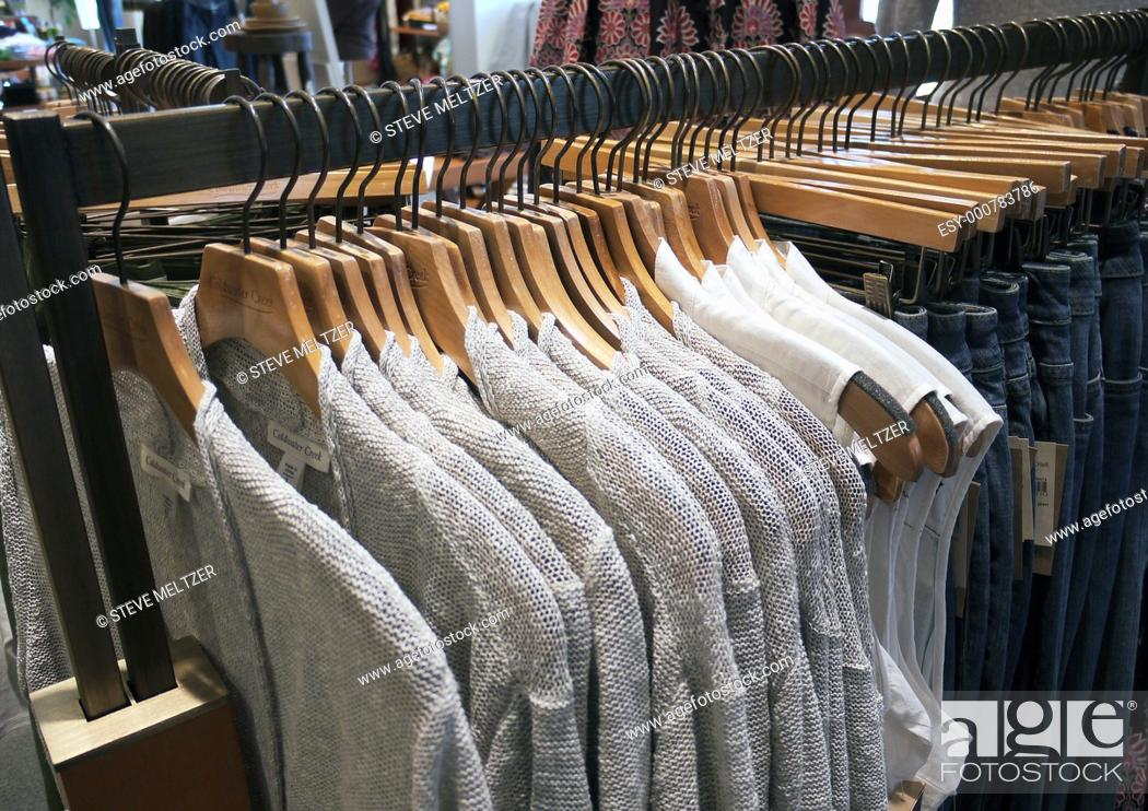 Stock Photo: Tees hirts on a store rack.