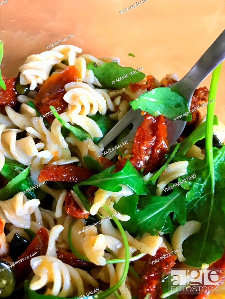 Stock Photo: Salad made of pasta, dried tomatoes and vegetables.