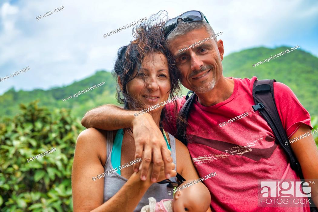 Stock Photo: Happy couple making selfie on a tropical island holding a dolly.