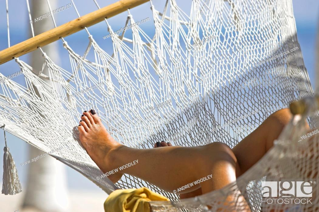 Stock Photo: Womans legs in hammock Isla Mujeres Mexico.