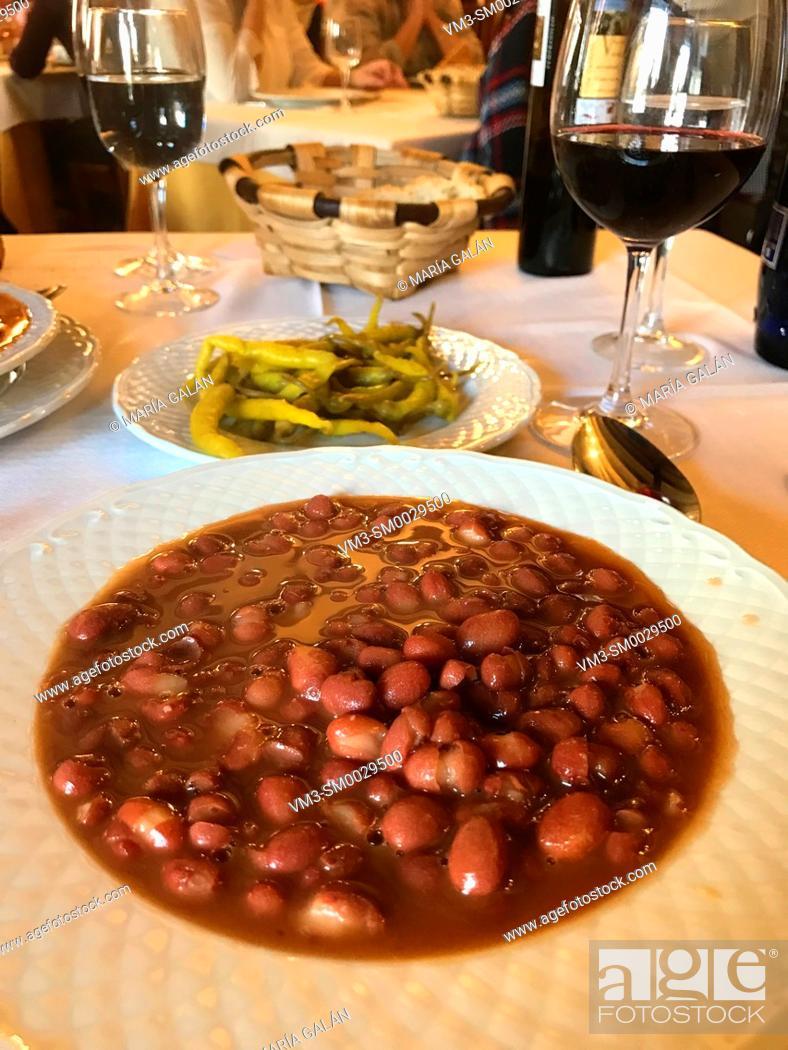Stock Photo: Olla podrida serving, traditional beans stew. Covarrubias, Burgos province, Spain.