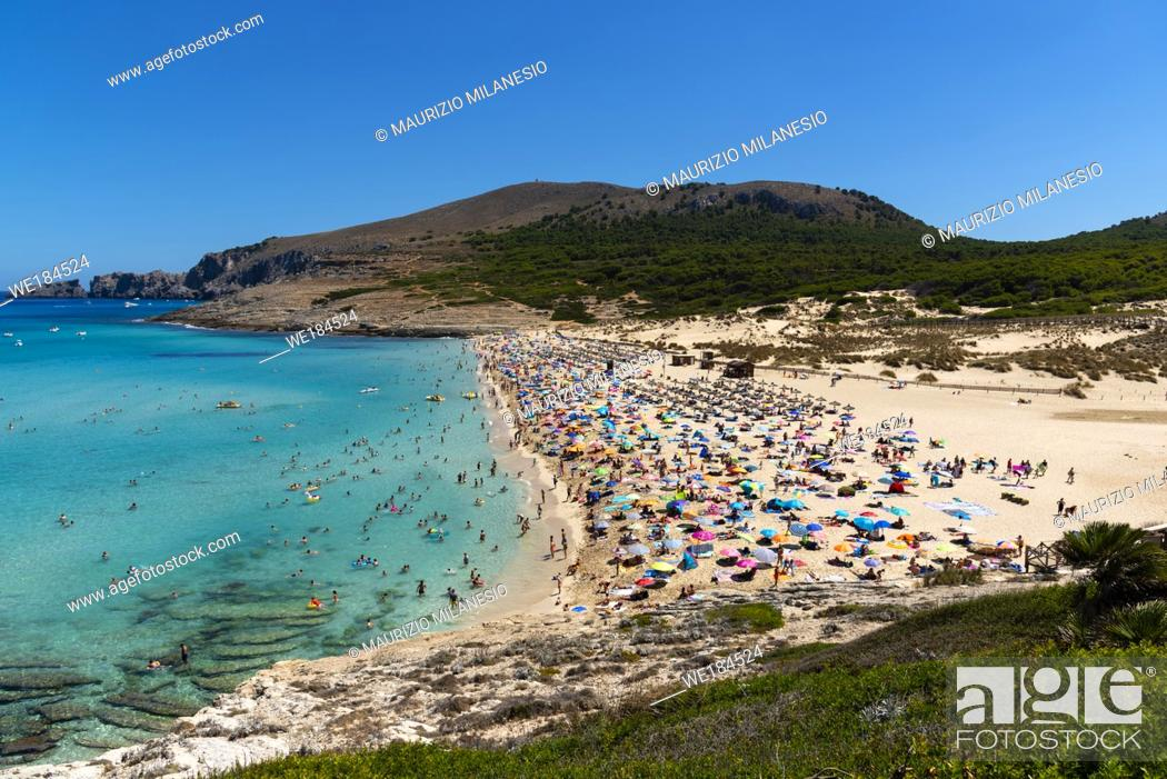 Stock Photo: view on the beach of Cala Mesquida Majorca Spain with many tourists and calm sea.