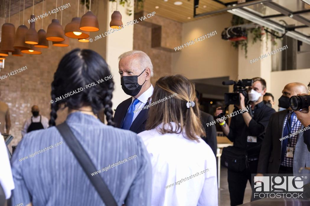 Stock Photo: United States President Joe Biden speaks to workers as he picks up tacos during a visit to Las Gemelas Restaurant in Washington, DC, USA, 05 May 2021.