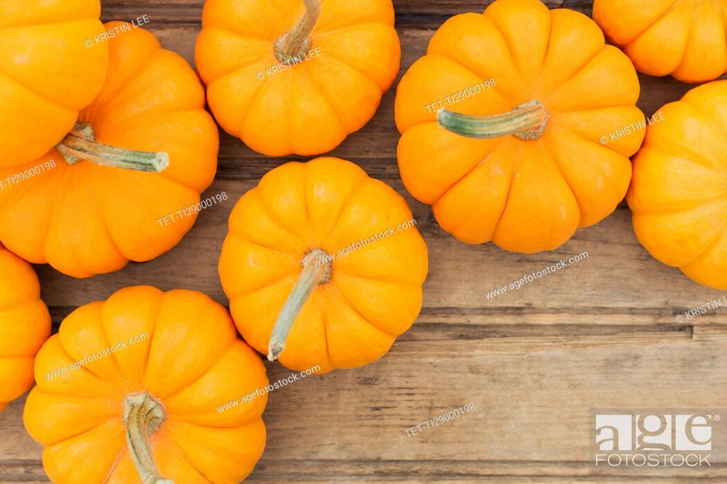 Stock Photo: Overhead view of yellow pumpkins.