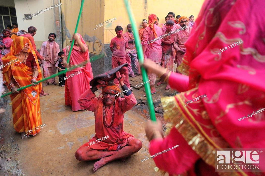 Stock Photo: India, Uttar Pradesh, Holi festival, Colour and spring festival celebrating the love between Krishna and Radha  Celebration of Lathmar Holi : On this particular.